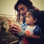 A cute pic of Riteish Deshmukh with his son Riaan on the set of Banjo movie