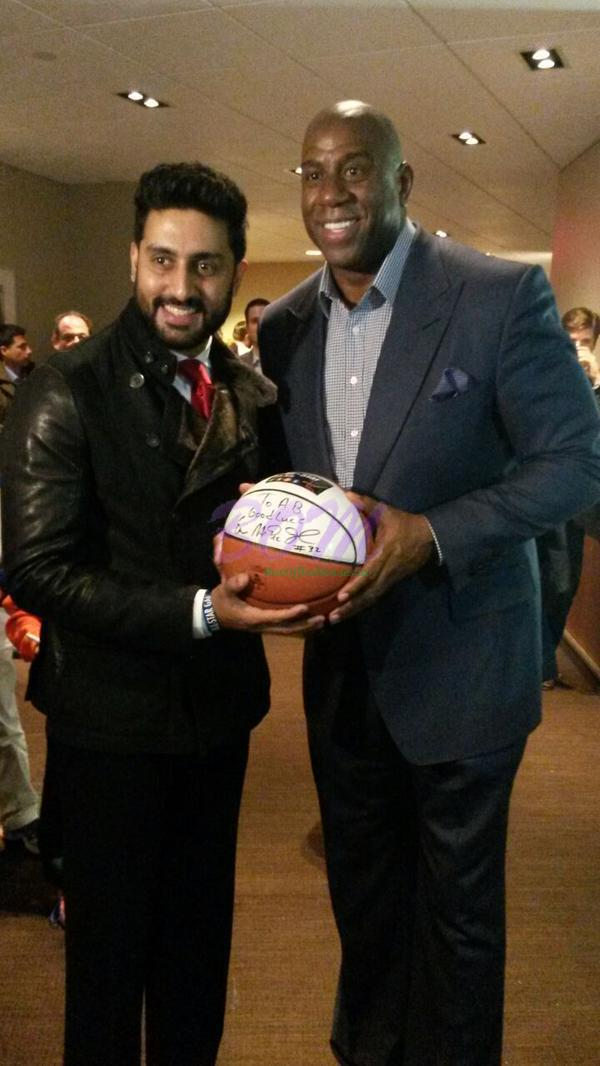 Abhishek Bachchan got his Spalding autographed by 5-time champion Johnson