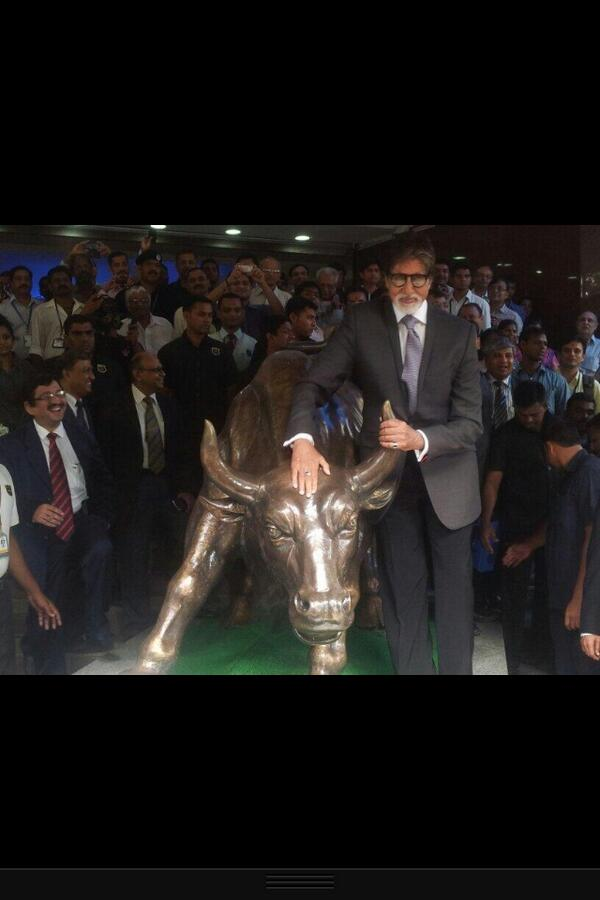 Amitabh Bachchan with The Bull. 'Rung the Bell' at the Bombay Stock Exchange and held the horns of the 'Bull..promotion for YUDH..thank you BSE for this honour.