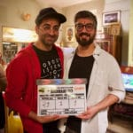 Ayushmann Khurrana holding the clipper of Badhaai Ho with the director