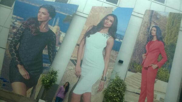 A fan of Deepika caught this picture where she is standing against wall and Deepika Padukone gorgeous posters on building walls.Deepika Padukone on building walls