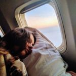 Evelyn Sharma sleeping selfie from an airplane travel