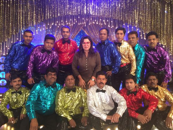 Farah Khan gives credit of a HNY Movie song to the dressed spot boys in this picture