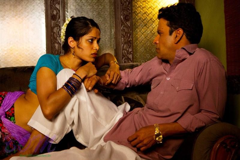 Freida Pinto with Manoj Bajpayee in a sizzling scene of Love Sonia movie