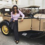 Kajol Devgn with a vintage car