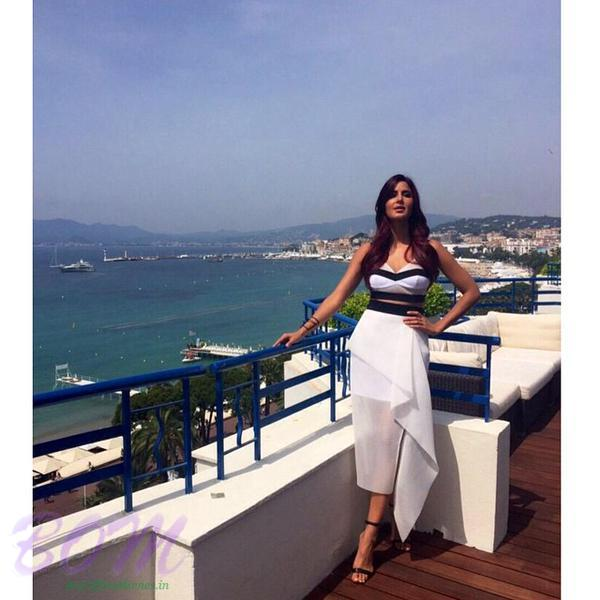 Katrina Kaif wears Manolo Blahnik Chaos black suede sandals and jewellery by Maria Francesca Pepe at Cannes