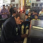 Mr. Bachchan playing the Charulata theme on the piano at St.Paul's Cathedral
