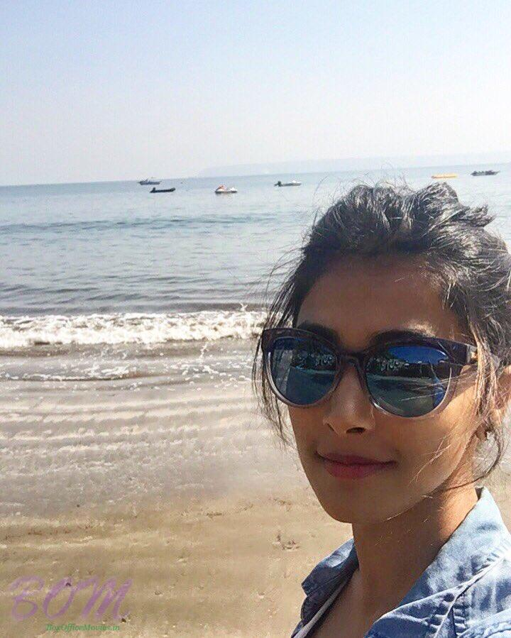 Pooja Hegde at a point where the sky touches the ocean