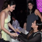 Rani Mukerji and Anushka Sharma greeting at an event