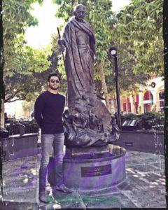 Ranveer Singh on Riverside, California with the statue of Mahatma Gandhi ji