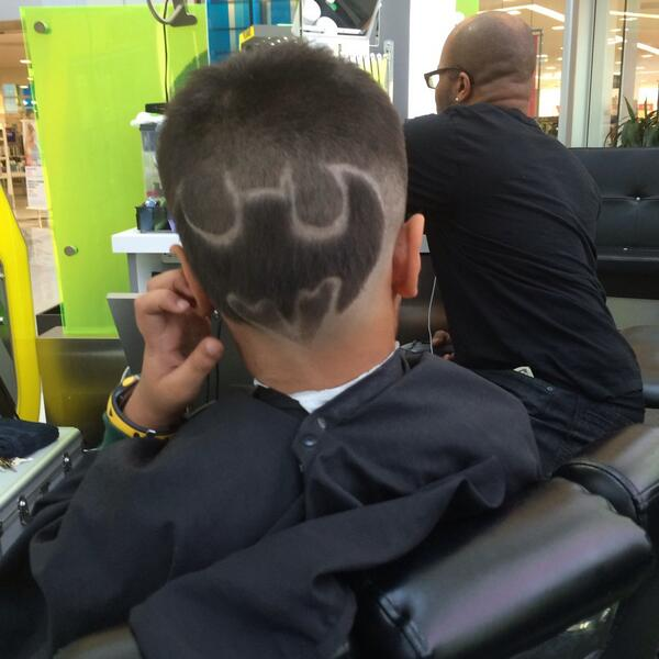 Raveena Tandon shared this pic 'Gets himself a batman haircut, And patiently sat through An hour and a half, Is a big super hero fan'
