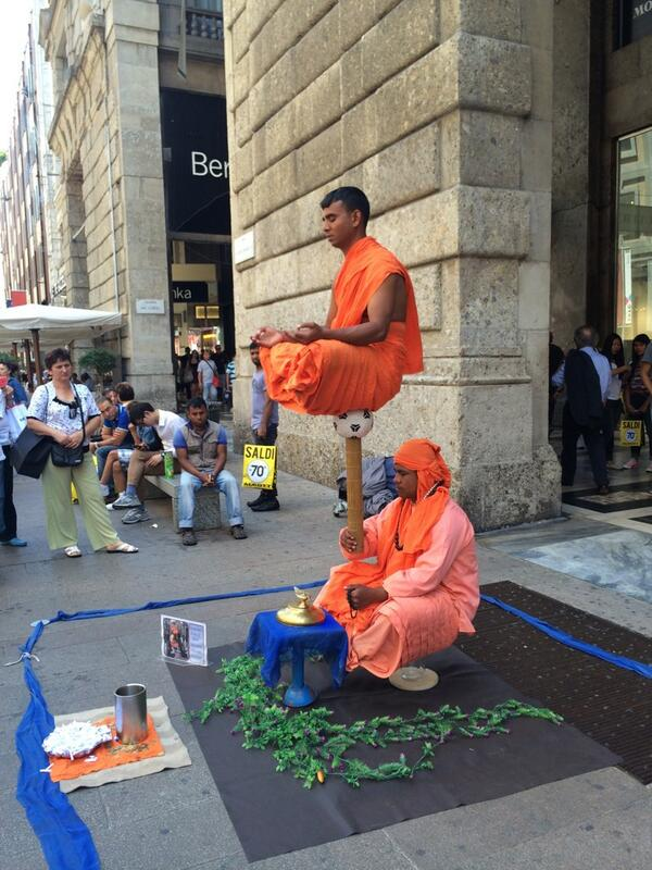 Sameera Reddy shared this picture 'Absolutely nuts!! Crazy balancing act! On the streets on Milan!'