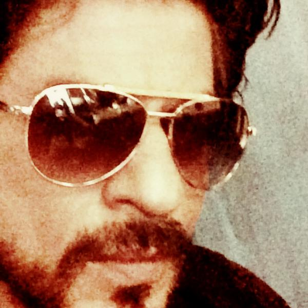 Shahrukh Khan wearing a glare given by Sonu Sood on 15 July 2014