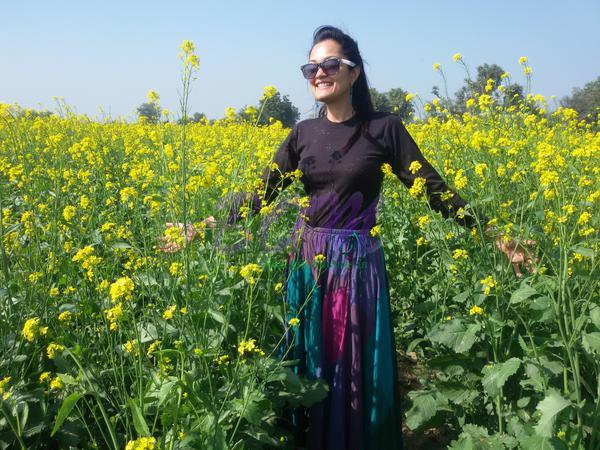 Sheena Chohan in between lovely fields