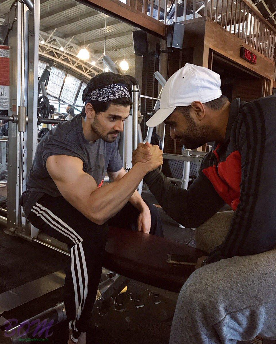 Sooraj Pancholi‏ arm wrestling with his trainer