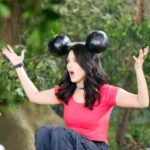 Sunny Leone holding a dumbell on her head