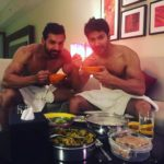 Varun Dhawan and John Abraham enjoying a deliciously heavy food
