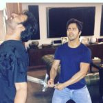 Varun Dhawan poses as Kattappa when swording to Prabhas