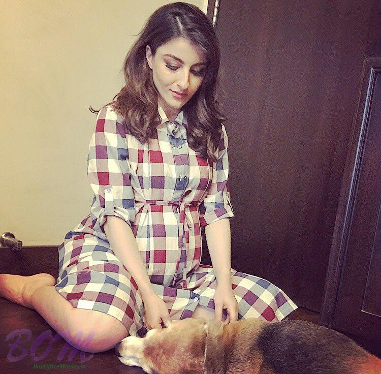 Soha Ali Khan with her dog while posing for a pic during pregnancy.